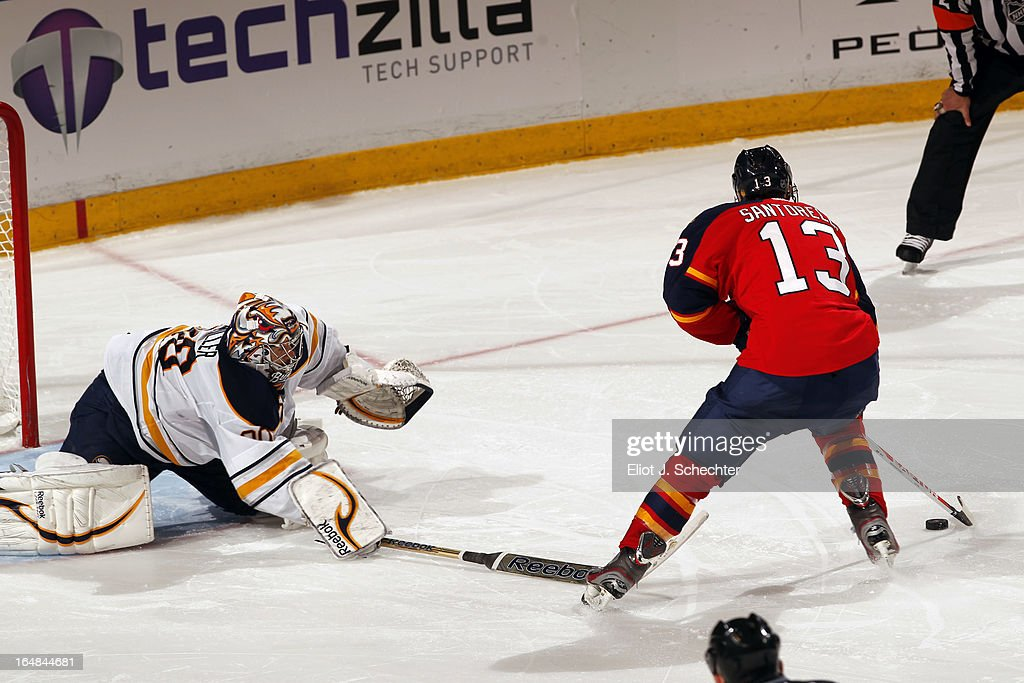 <a gi-track='captionPersonalityLinkClicked' href=/galleries/search?phrase=Mike+Santorelli&family=editorial&specificpeople=4517042 ng-click='$event.stopPropagation()'>Mike Santorelli</a> #13 of the Florida Panthers shoots and scores the game winning goal in a shot out against Goaltender Ryan Miller #30 of the Buffalo Sabres at the BB&T Center on March 28, 2013 in Sunrise, Florida.