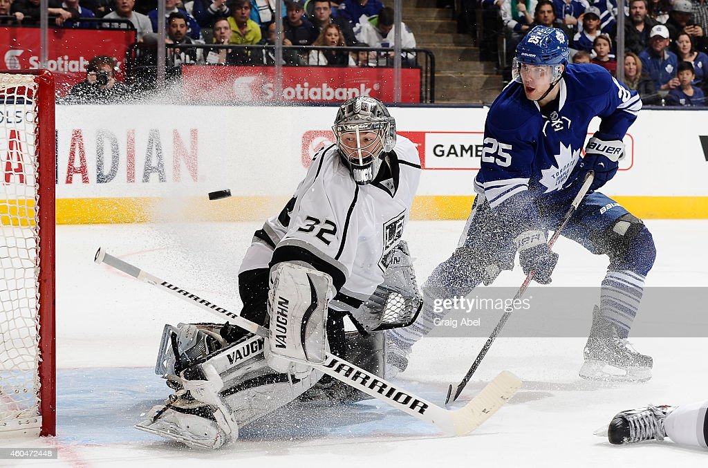 <a gi-track='captionPersonalityLinkClicked' href=/galleries/search?phrase=Mike+Santorelli&family=editorial&specificpeople=4517042 ng-click='$event.stopPropagation()'>Mike Santorelli</a> #25 of the Toronto Maple Leafs is stopped in close as <a gi-track='captionPersonalityLinkClicked' href=/galleries/search?phrase=Jonathan+Quick&family=editorial&specificpeople=2271852 ng-click='$event.stopPropagation()'>Jonathan Quick</a> #32 of the Los Angeles Kings makes a blocker save during NHL game action December 14, 2014 at the Air Canada Centre in Toronto, Ontario, Canada.