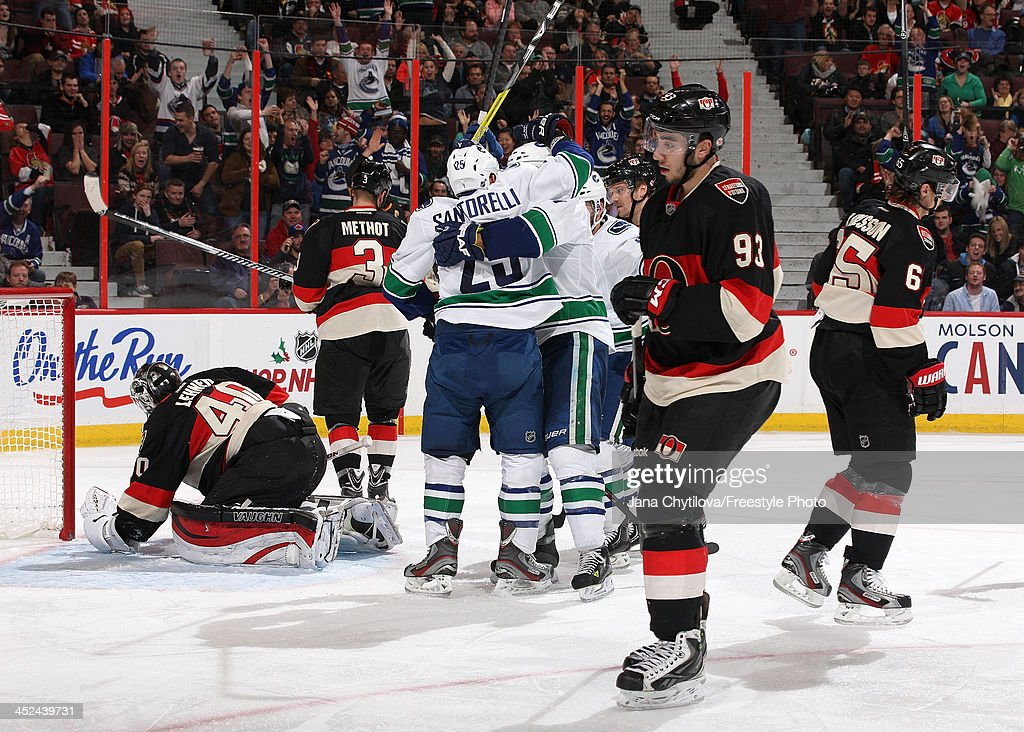 <a gi-track='captionPersonalityLinkClicked' href=/galleries/search?phrase=Mike+Santorelli&family=editorial&specificpeople=4517042 ng-click='$event.stopPropagation()'>Mike Santorelli</a> #25 of the Vancouver Canucks celebrates a third period goal during an NHL game against the Ottawa Senators as <a gi-track='captionPersonalityLinkClicked' href=/galleries/search?phrase=Mika+Zibanejad&family=editorial&specificpeople=7832310 ng-click='$event.stopPropagation()'>Mika Zibanejad</a> #93, <a gi-track='captionPersonalityLinkClicked' href=/galleries/search?phrase=Erik+Karlsson&family=editorial&specificpeople=5370939 ng-click='$event.stopPropagation()'>Erik Karlsson</a> #65, <a gi-track='captionPersonalityLinkClicked' href=/galleries/search?phrase=Marc+Methot&family=editorial&specificpeople=2216900 ng-click='$event.stopPropagation()'>Marc Methot</a> #3 and <a gi-track='captionPersonalityLinkClicked' href=/galleries/search?phrase=Robin+Lehner&family=editorial&specificpeople=5894610 ng-click='$event.stopPropagation()'>Robin Lehner</a> #40 of the Ottawa Senators look on at Canadian Tire Centre on November 28, 2013 in Ottawa, Ontario, Canada.
