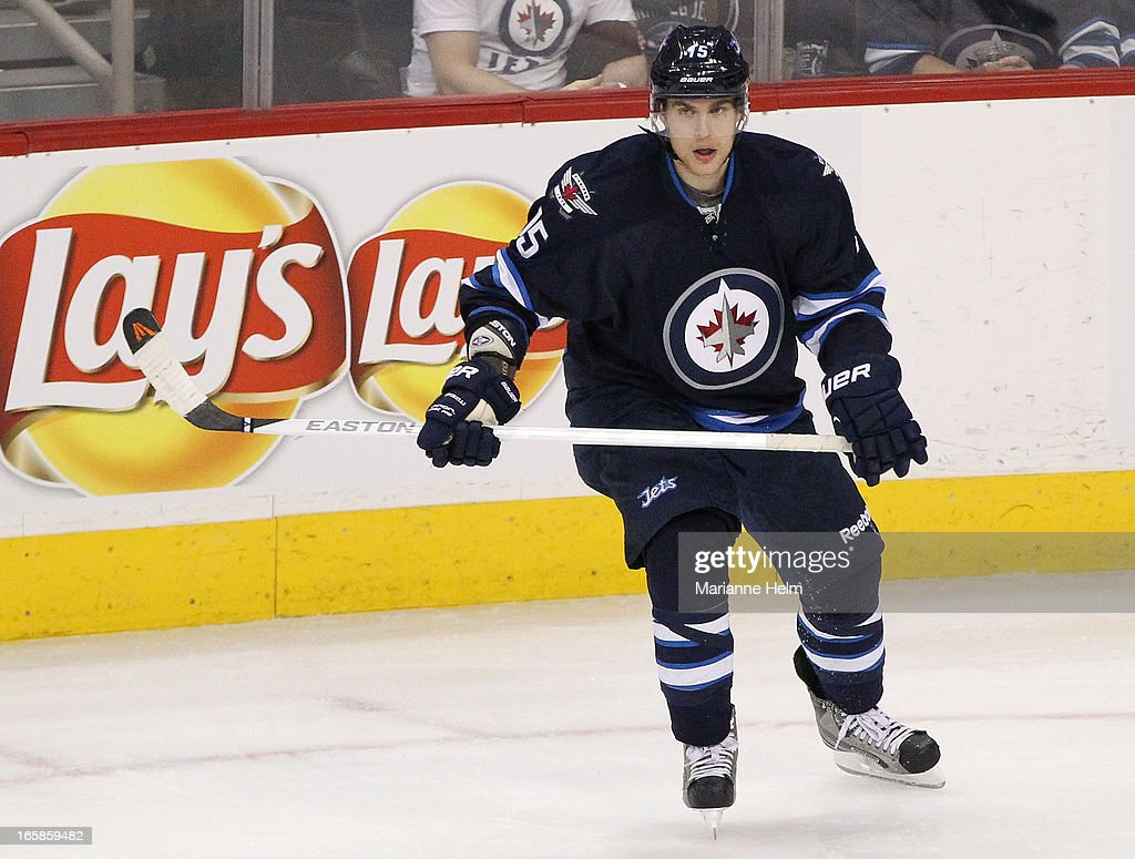<a gi-track='captionPersonalityLinkClicked' href=/galleries/search?phrase=Mike+Santorelli&family=editorial&specificpeople=4517042 ng-click='$event.stopPropagation()'>Mike Santorelli</a> #15 of the Winnipeg Jets skates on the ice during first period in a game between the Winnipeg Jets and the Philadelphia Flyers on April 6, 2013 at the MTS Centre in Winnipeg, Manitoba, Canada.