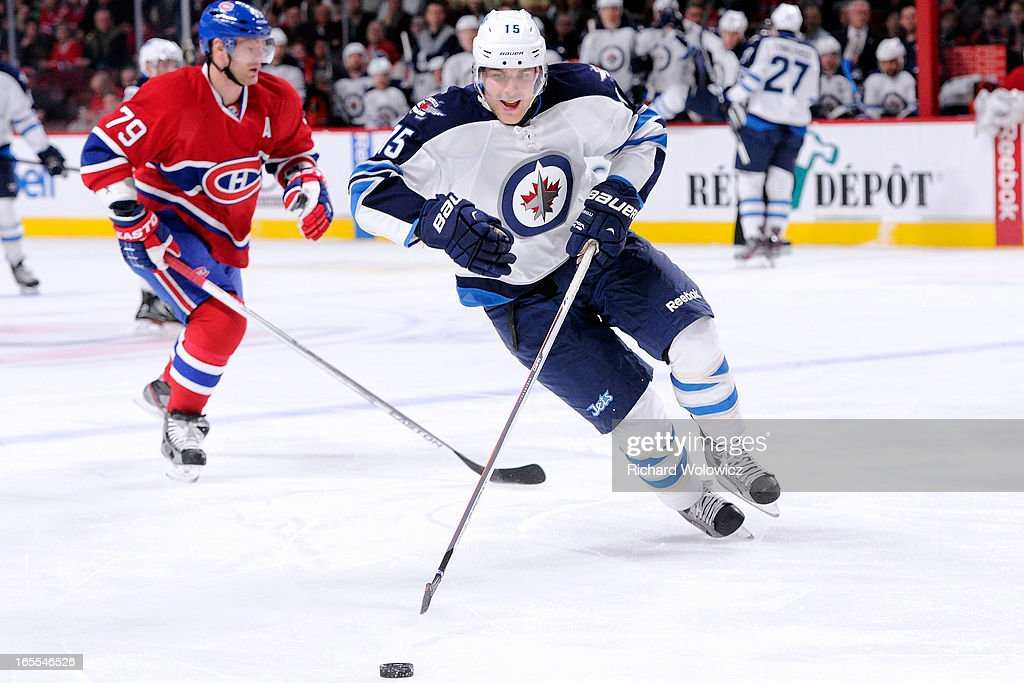 <a gi-track='captionPersonalityLinkClicked' href=/galleries/search?phrase=Mike+Santorelli&family=editorial&specificpeople=4517042 ng-click='$event.stopPropagation()'>Mike Santorelli</a> #15 of the Winnipeg Jets skates with the puck during the NHL game against the Montreal Canadiens at the Bell Centre on April 4, 2013 in Montreal, Quebec, Canada. The Canadiens defeated the Jets 4-1.