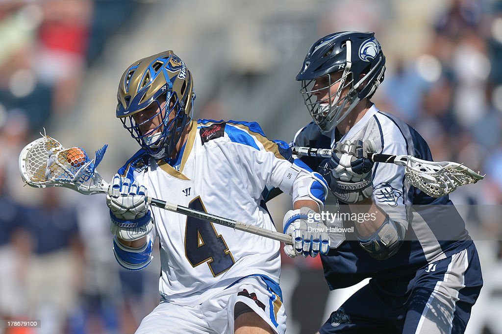 Mike Sawyer #4 of the Charlotte Hounds is checked by Matt Abbott #3 of the Chesapeake Bayhawks during the MLL Championship at PPL Park on August 25, 2013 in Chester, Pennsylvania.