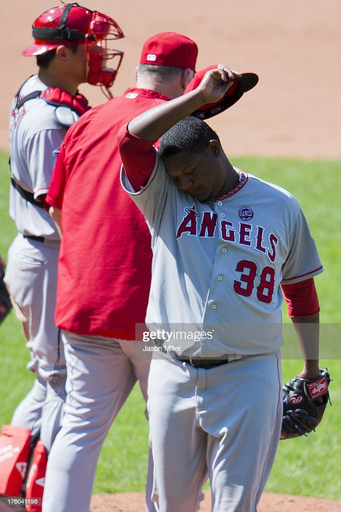 <a gi-track='captionPersonalityLinkClicked' href=/galleries/search?phrase=Mike+Scioscia&family=editorial&specificpeople=206319 ng-click='$event.stopPropagation()'>Mike Scioscia</a> #14 removes relief pitcher J.C. Gutierrez #38 of the Los Angeles Angels of Anaheim from the game during the seventh inning against the Cleveland Indians at Progressive Field on August 11, 2013 in Cleveland, Ohio.