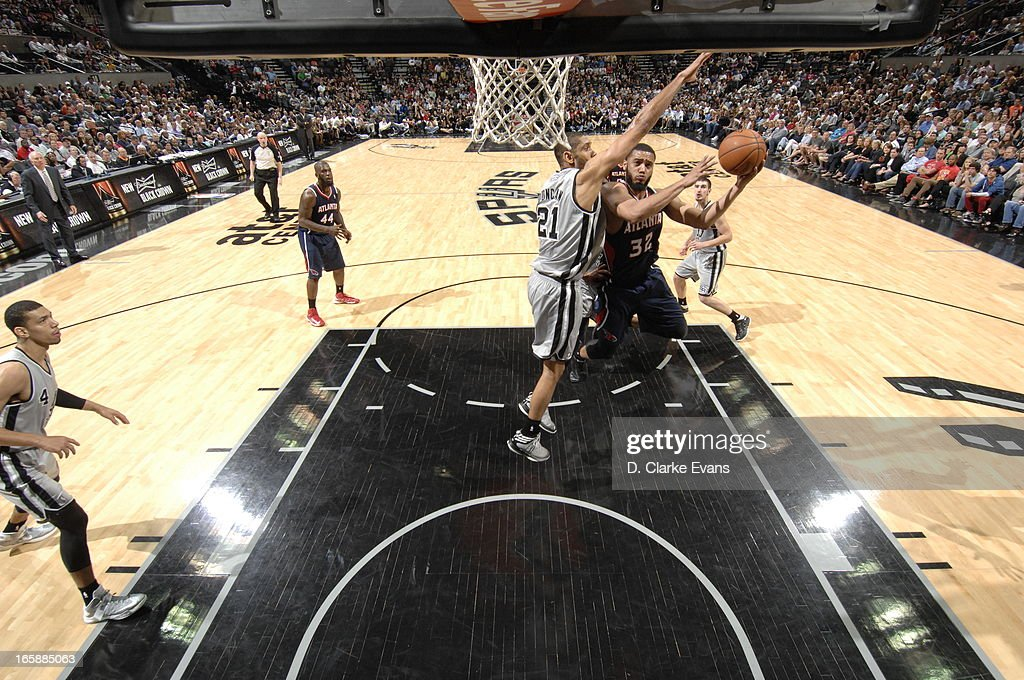 Mike Scott #32 of the Atlanta Hawks against <a gi-track='captionPersonalityLinkClicked' href=/galleries/search?phrase=Tim+Duncan&family=editorial&specificpeople=201467 ng-click='$event.stopPropagation()'>Tim Duncan</a> #21 of the San Antonio Spurs on April 6, 2013 at the AT&T Center in San Antonio, Texas.
