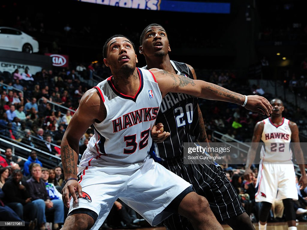 Mike Scott #32 of the Atlanta Hawks and <a gi-track='captionPersonalityLinkClicked' href=/galleries/search?phrase=DeQuan+Jones&family=editorial&specificpeople=5626127 ng-click='$event.stopPropagation()'>DeQuan Jones</a> #20 of the Orlando Magic wait for a rebound during the game between the Atlanta Hawks and the Orlando Magic at Philips Arena on November 19, 2012 in Atlanta, Georgia.