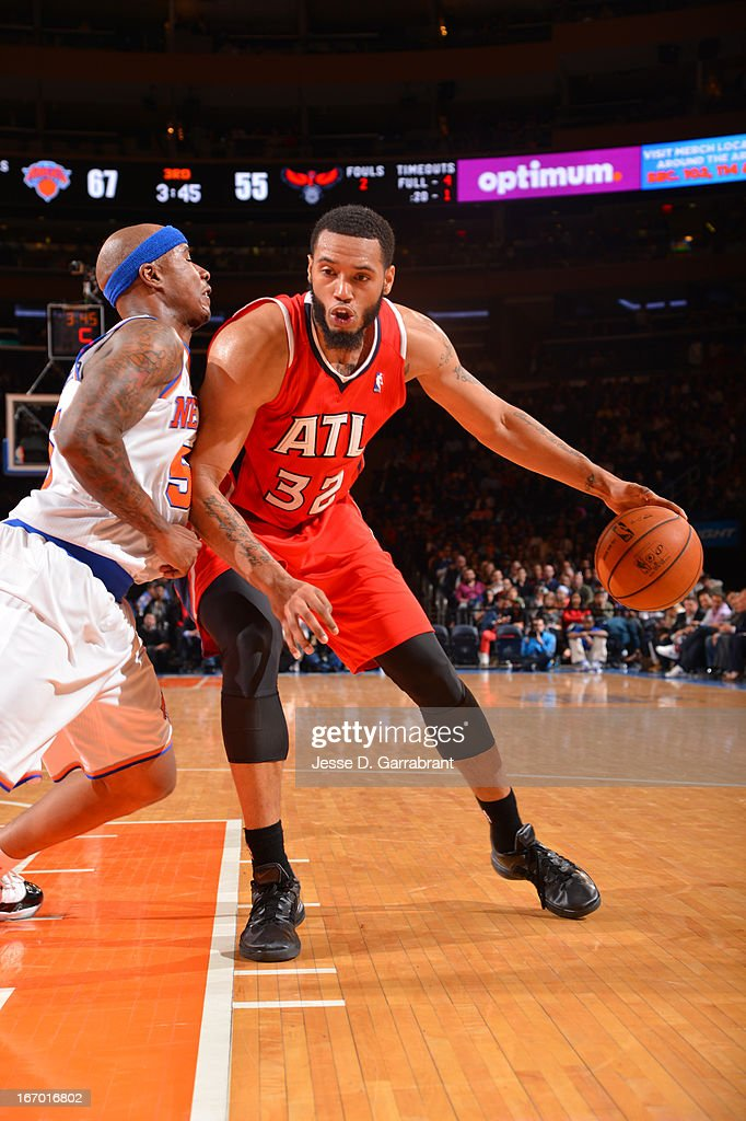 Mike Scott #32 of the Atlanta Hawks backs down to the basket against the New York Knicks on April 17, 2013 at Madison Square Garden in New York City, New York.