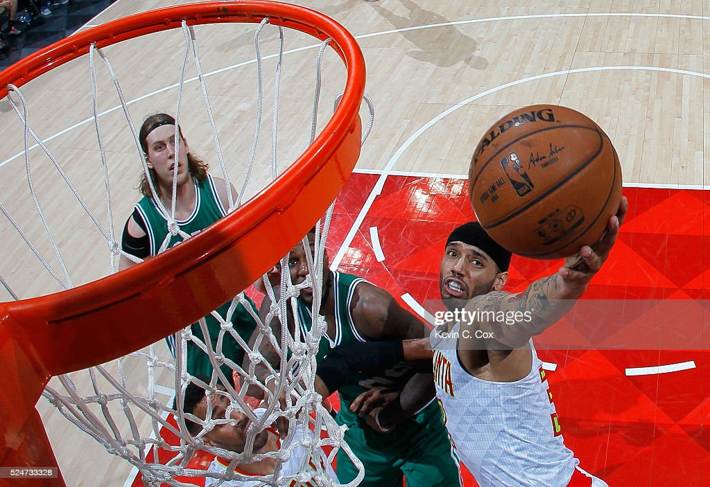 Mike Scott #32 of the Atlanta Hawks battles under the basket against Jae Crowder #99 of the Boston Celtics in Game Five of the Eastern Conference Quarterfinals during the 2016 NBA Playoffs at Philips Arena on April 26, 2016 in Atlanta, Georgia. NOTE TO USER User expressly acknowledges and agrees that, by downloading and or using this photograph, user is consenting to the terms and conditions of the Getty Images License Agreement.