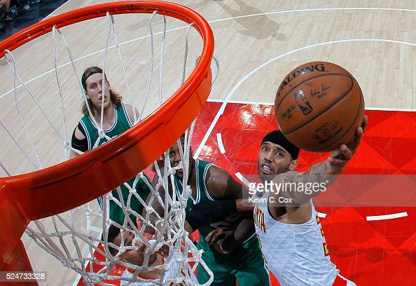 Mike Scott of the Atlanta Hawks battles under the basket against Jae Crowder of the Boston Celtics in Game Five of the Eastern Conference...