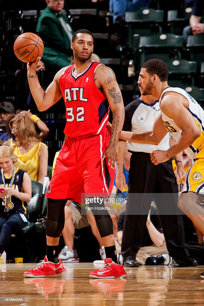 Mike Scott #32 of the Atlanta Hawks controls the ball against Jeff Pendergraph #29 of the Indiana Pacers in Game Five of the Eastern Conference Quarterfinals during the 2013 NBA Playoffs on May 1, 2013 at Bankers Life Fieldhouse in Indianapolis, Indiana.