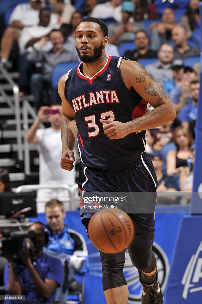 Mike Scott #32 of the Atlanta Hawks dribbles the ball up the court against the Orlando Magic during the game on February 13, 2013 at Amway Center in Orlando, Florida.