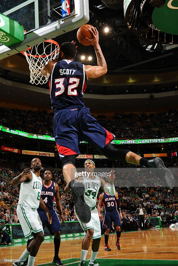 Mike Scott #32 of the Atlanta Hawks dunks the ball against the Boston Celtics on March 29, 2013 at the TD Garden in Boston, Massachusetts.