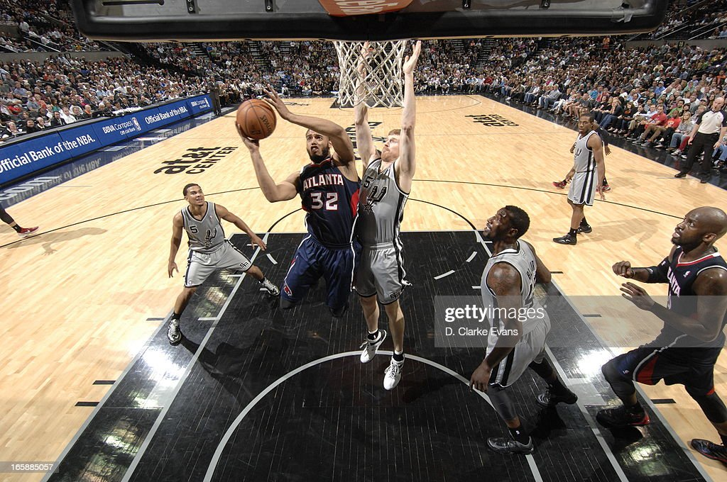 Mike Scott #32 of the Atlanta Hawks goes to the basket against <a gi-track='captionPersonalityLinkClicked' href=/galleries/search?phrase=Matt+Bonner&family=editorial&specificpeople=203054 ng-click='$event.stopPropagation()'>Matt Bonner</a> #15 of the San Antonio Spurs on April 6, 2013 at the AT&T Center in San Antonio, Texas.