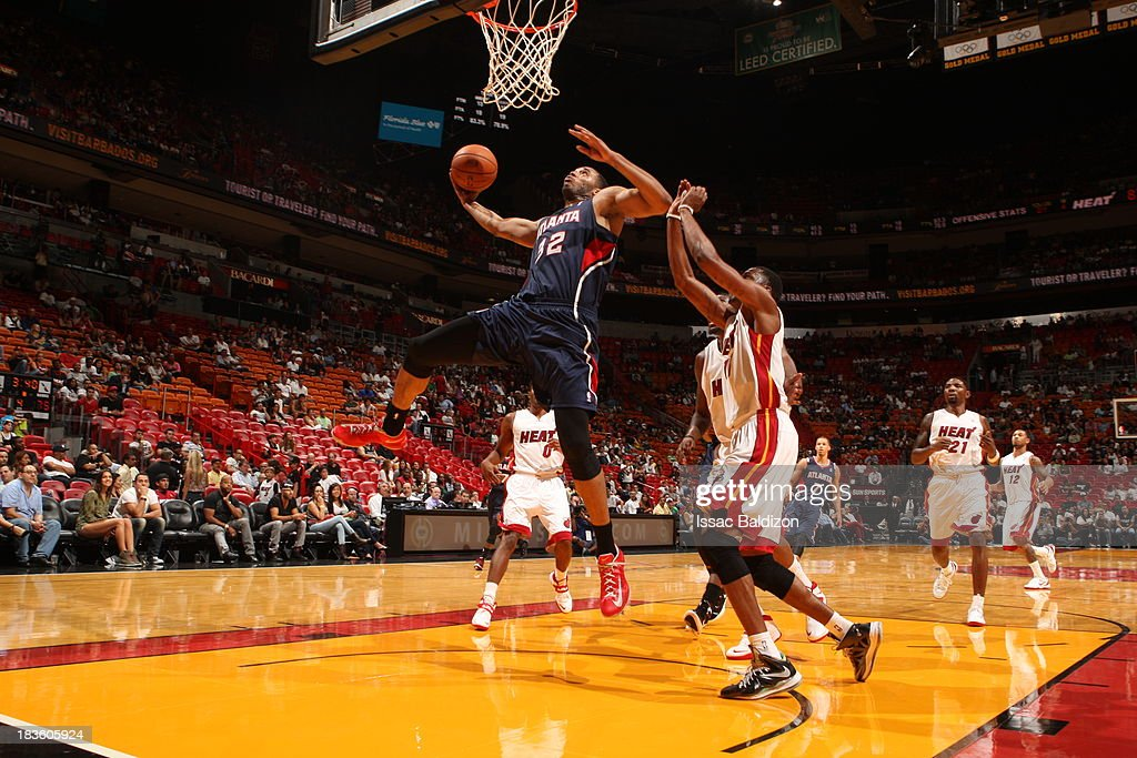 Mike Scott #32 of the Atlanta Hawks goes up for the dunk against the Miami Heat during a game on October 7, 2013 at American Airlines Arena in Miami, Florida.