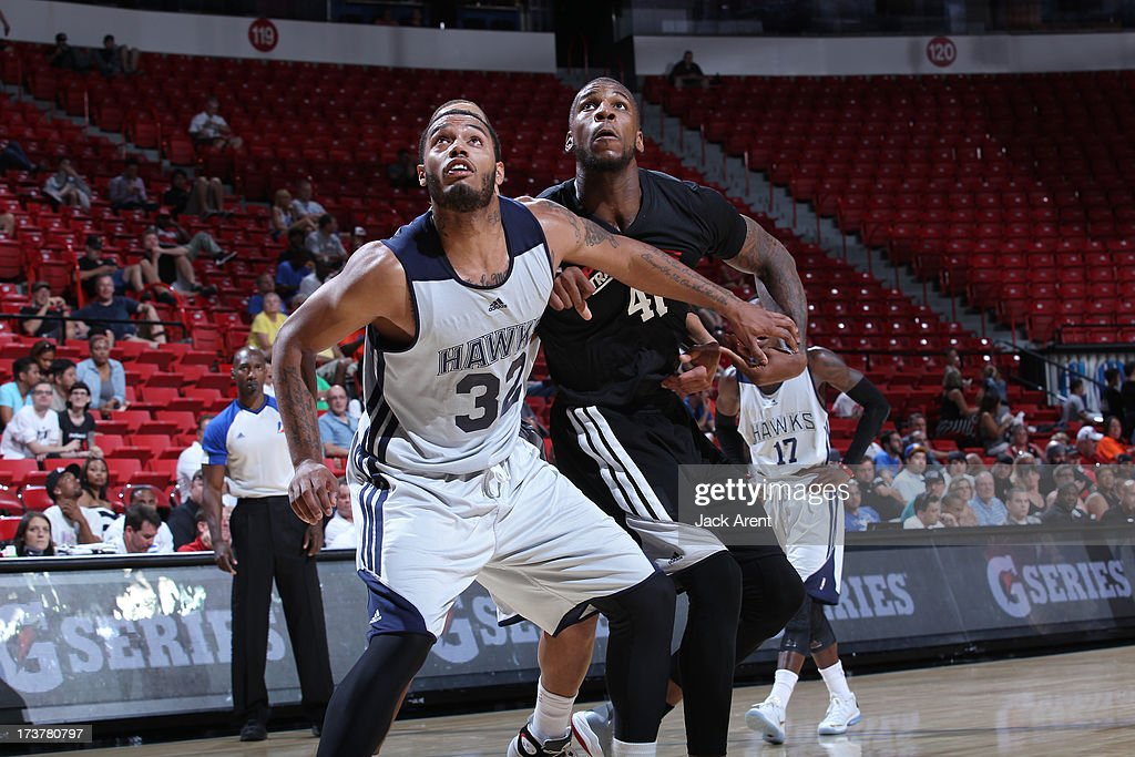 Mike Scott of the Atlanta Hawks guards Thomas Robinson of the Portland Trail Blazers during the NBA Summer League game between the Atlanta Hawks and...