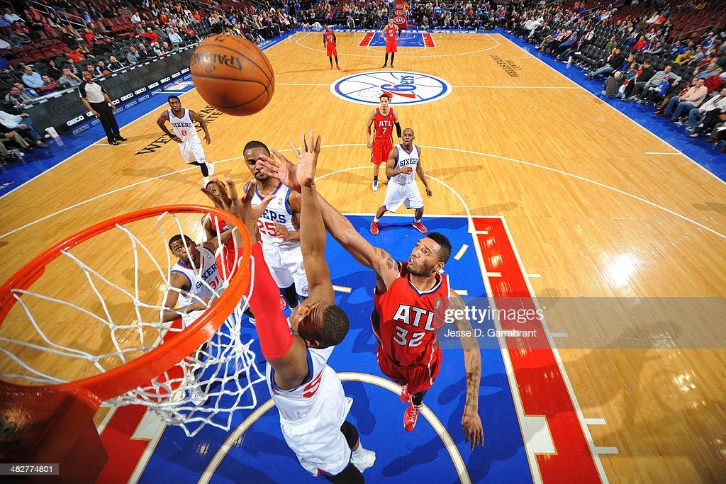 Mike Scott #32 of the Atlanta Hawks reaches for a rebound against the Philadelphia 76ers at the Wells Fargo Center on January 31, 2014 in Philadelphia, Pennsylvania.