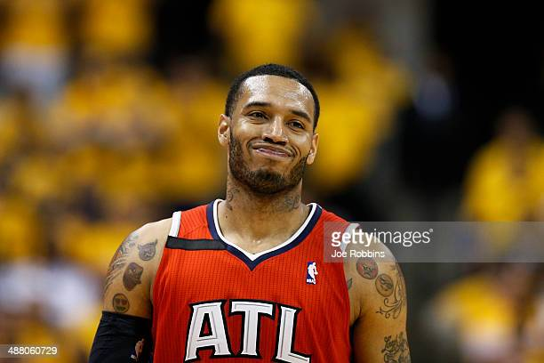 Mike Scott of the Atlanta Hawks reacts against the Indiana Pacers during Game Seven of the Eastern Conference Quarterfinals of the 2014 NBA Playoffs...