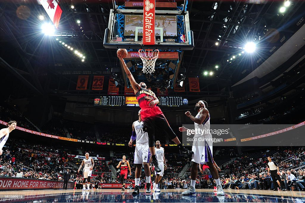 Mike Scott #32 of the Atlanta Hawks shoots a layup against <a gi-track='captionPersonalityLinkClicked' href=/galleries/search?phrase=John+Salmons&family=editorial&specificpeople=202524 ng-click='$event.stopPropagation()'>John Salmons</a> #5 of the Sacramento Kings on February 22, 2013 at Philips Arena in Atlanta, Georgia.