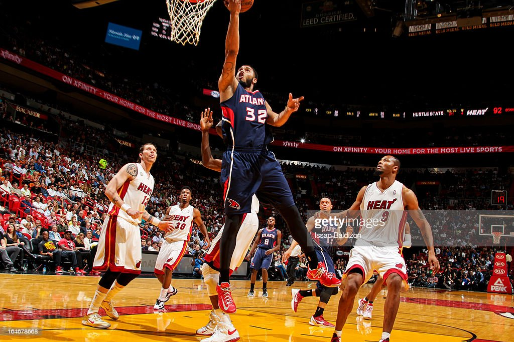 Mike Scott #32 of the Atlanta Hawks shoots a layup against the Miami Heat on March 12, 2013 at American Airlines Arena in Miami, Florida.