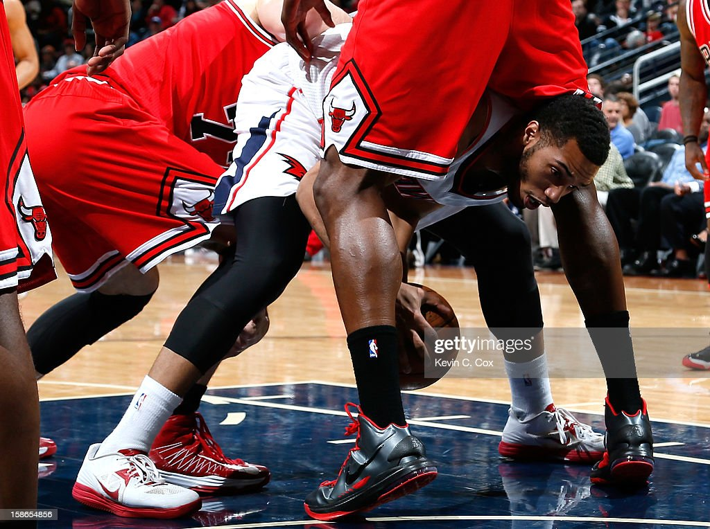 Mike Scott #32 of the Atlanta Hawks shoots grabs a loose ball under <a gi-track='captionPersonalityLinkClicked' href=/galleries/search?phrase=Nazr+Mohammed&family=editorial&specificpeople=201690 ng-click='$event.stopPropagation()'>Nazr Mohammed</a> #48 of the Chicago Bulls at Philips Arena on December 22, 2012 in Atlanta, Georgia.