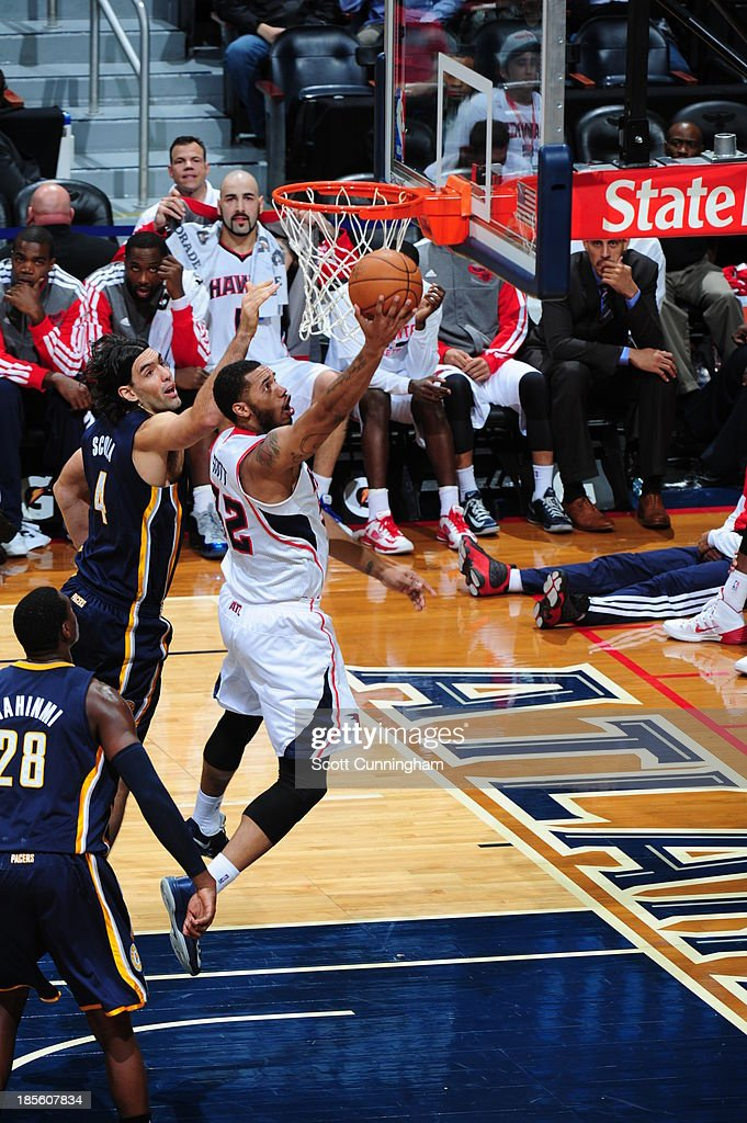Mike Scott #32 of the Atlanta Hawks shoots the ball against <a gi-track='captionPersonalityLinkClicked' href=/galleries/search?phrase=Luis+Scola&family=editorial&specificpeople=2464749 ng-click='$event.stopPropagation()'>Luis Scola</a> #4 of the Indiana Pacers on October 22, 2013 at Philips Arena in Atlanta, Georgia.