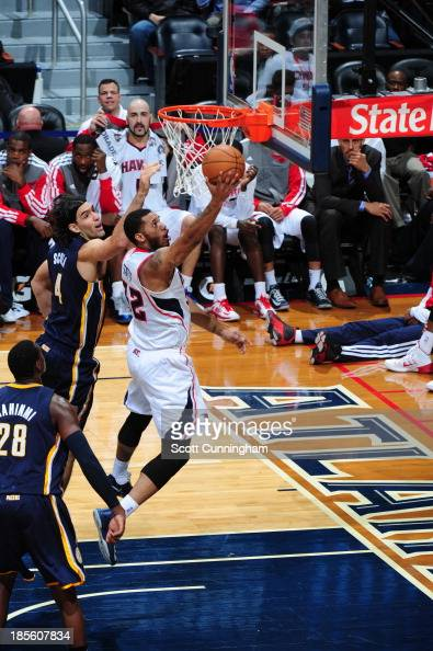 Mike Scott of the Atlanta Hawks shoots the ball against Luis Scola of the Indiana Pacers on October 22 2013 at Philips Arena in Atlanta Georgia NOTE...