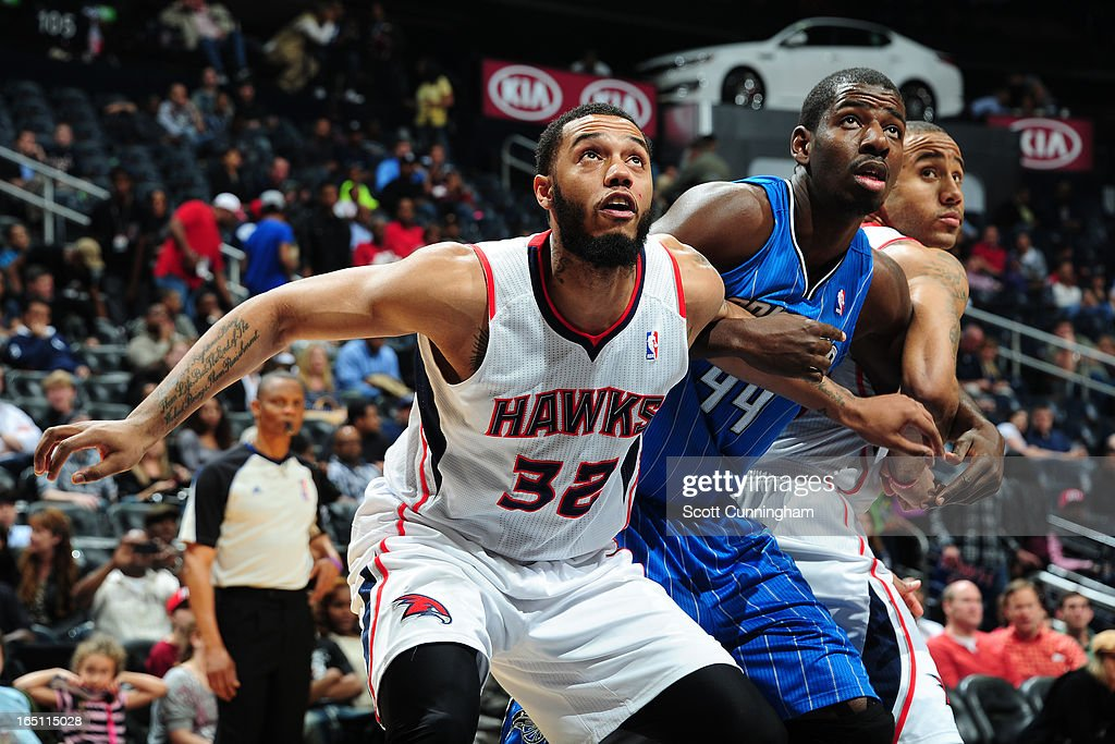 Mike Scott #32 of the Atlanta Hawks waits for the rebound against Andrew Nicholson #44 of the Orlando Magic on March 30, 2013 at Philips Arena in Atlanta, Georgia.