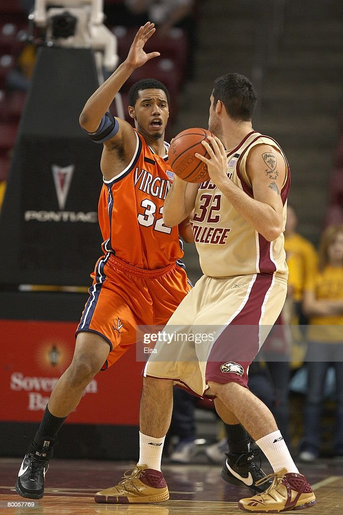 Mike Scott of the Virginia Cavaliers guards John Oates of the Boston College Eagles on February 17 2008 at Alumni Stadium in in Chestnut Hill...