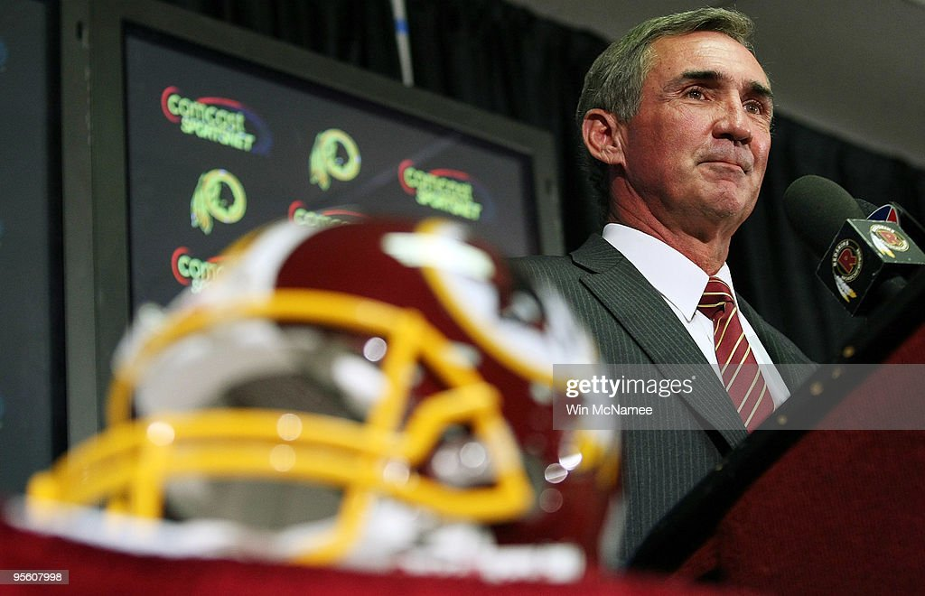 <a gi-track='captionPersonalityLinkClicked' href=/galleries/search?phrase=Mike+Shanahan&family=editorial&specificpeople=213113 ng-click='$event.stopPropagation()'>Mike Shanahan</a> answers questions at a press conference where he was introduced as the new head coach of the Washington Redskins on January 6, 2010 in Ashburn, Virginia. Shanahan replaces former head coach Jim Zorn who was released January 4 following a 4-12 season.