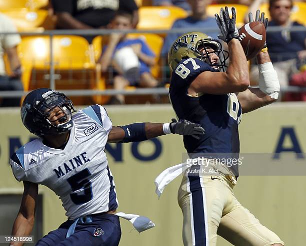Mike Shanahan of the Pittsburgh Panthers catches a pass against Kendall James of the Maine Black Bears but is overturned because of offensive pass...