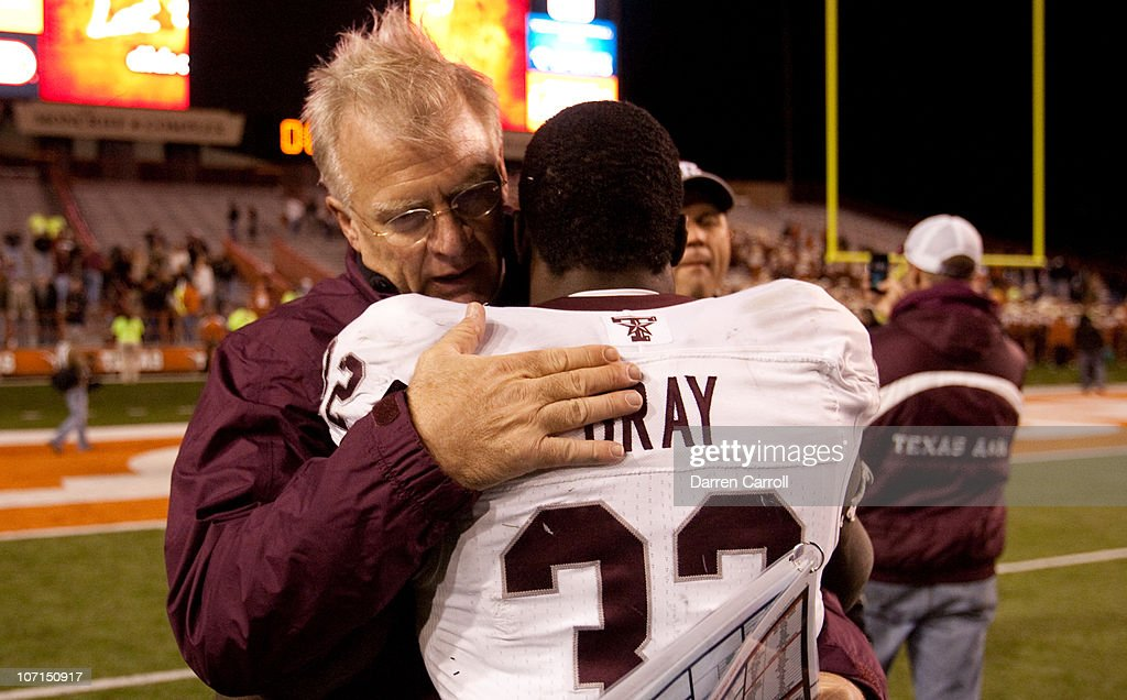 Mike Sherman, head coach of Texas A&M, embraces running back Cyrus Gray #32 following Texas A&M's 24-17 win over The University of Texas at Darrell K. Royal-Texas Memorial Stadium on November 25, 2010 in Austin, Texas.