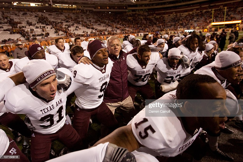 <a gi-track='captionPersonalityLinkClicked' href=/galleries/search?phrase=Mike+Sherman&family=editorial&specificpeople=211132 ng-click='$event.stopPropagation()'>Mike Sherman</a>, head coach of Texas A&M, joins players in a post-game singing of the Aggie War Hymn following Texas A&M's 24-17 win over the University of Texas at Darrell K. Royal-Texas Memorial Stadium on November 25, 2010 in Austin, Texas.