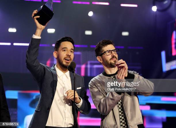 Mike Shinoda and Brad Delson of music group Linkin Park accept the Favorite Artist Alternative Rock award onstage during the 2017 American Music...