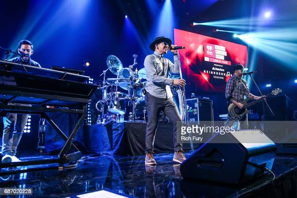 Mike Shinoda Chester Bennington and Dave Farrell of Linkin Park performs on stage at the iHeartRadio Album Release Party presented by State Farm at...
