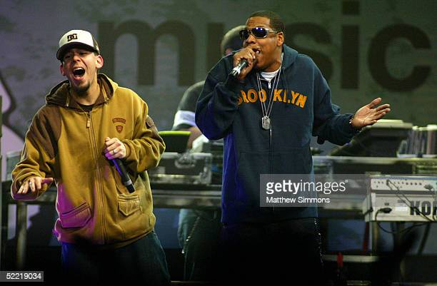 Mike Shinoda of Linkin Park and JayZ perform during the 'Music for Relief' tsunami benefit concert at the Anaheim Pond on February 18 2005 in Anaheim...