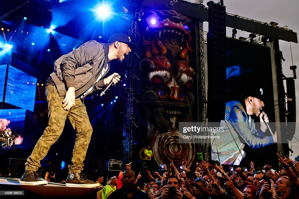 <a gi-track='captionPersonalityLinkClicked' href=/galleries/search?phrase=Mike+Shinoda&family=editorial&specificpeople=657527 ng-click='$event.stopPropagation()'>Mike Shinoda</a> of Linkin Park performs on stage during day 2 of Download Festival at Donnington Park on June 14, 2014 in Donnington, United Kingdom.