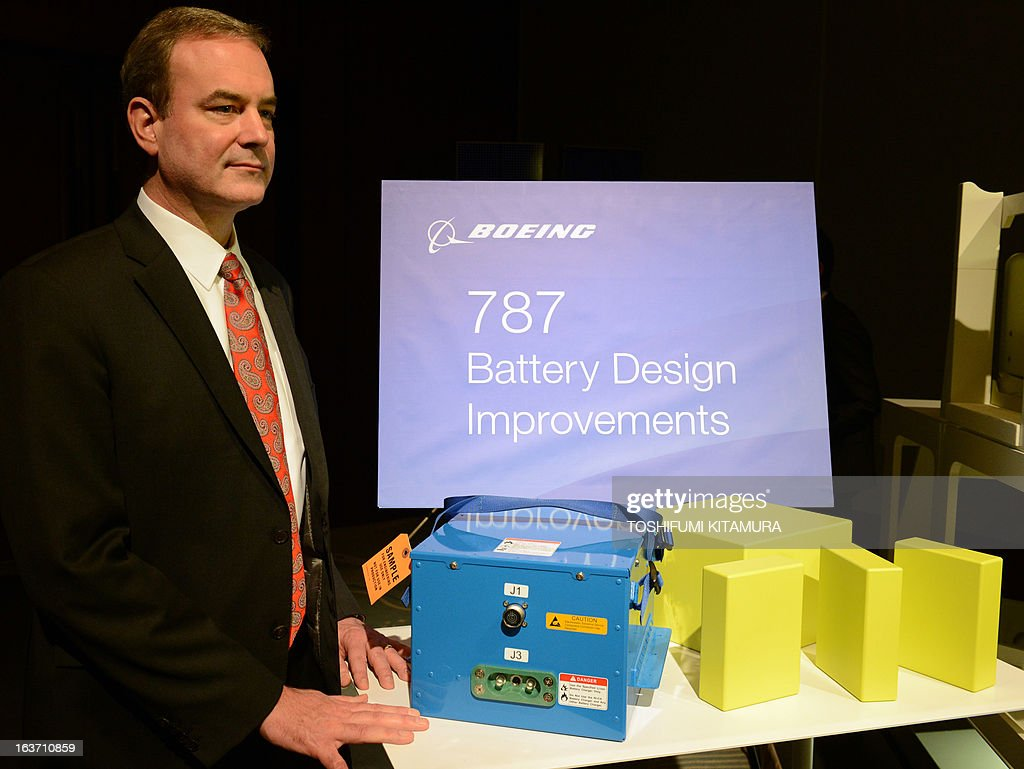 Mike Sinnett, the chief project engineer on the Boeing 787, poses at a photo session with an improved battery for the 787 Dreamliner series during a press conference in Tokyo on March 15, 2013. The grounded Dreamliner is 'absolutely' safe and will be back in the air within weeks, planemaker Boeing said in Japan, as it sought to reassure airlines and fliers about its aircraft.