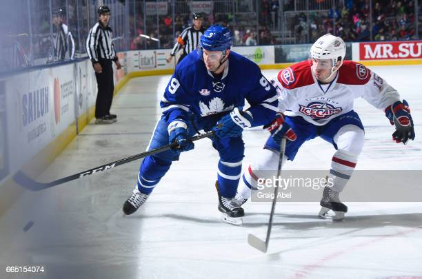 Mike Sislo of the Toronto Marlies controls the puck against Joel Hanley of the St John's IceCaps during AHL game action on April 4 2017 at Ricoh...