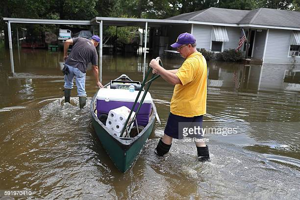 Mike Sittig and Nelson Morgan jr bring supplies to Nelson's fathers home to begin the process of cleaning up after flood waters inundated it on...