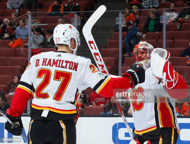 Mike Smith and Dougie Hamilton of the Calgary Flames celebrate a 20 win over the Anaheim Ducks on October 9 2017 at Honda Center in Anaheim California