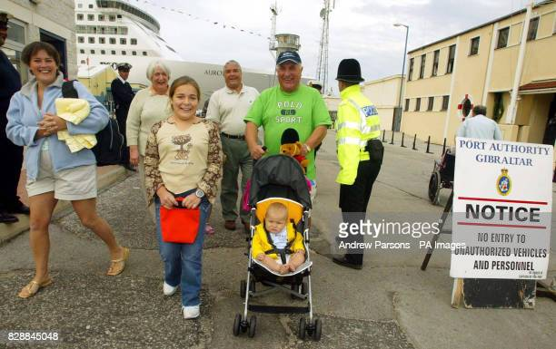 Mike Smith and his wife Tina from St Peter Port Guernsey and children Becky and James 10 months leave the PO cruiser Aurora after it docked in...