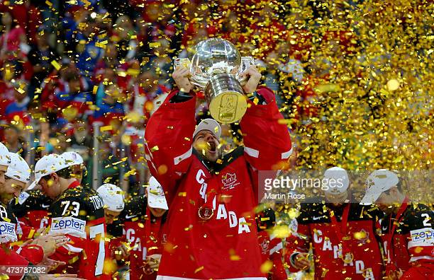 Mike Smith goaltender of Canada lifts the trophy after winning the IIHF World Championship gold medal match between Canada and Russia at O2 Arena on...