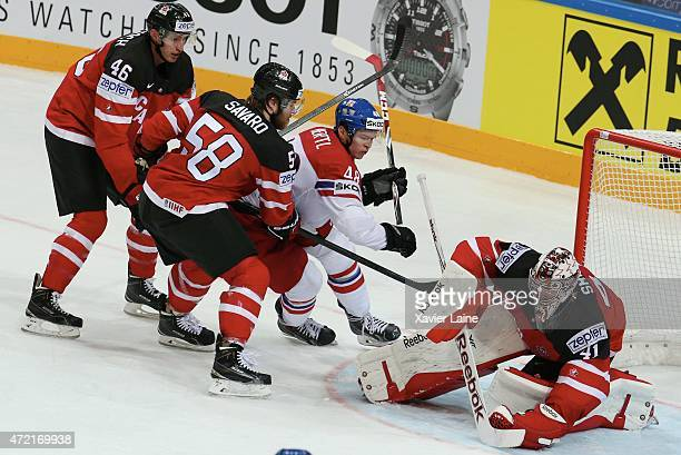Mike Smith of Canada stops the puck ahead David Savard Patrick Wiercioch and Tomas Hertl of Czech Republic during the 2015 IIHF World Championship...