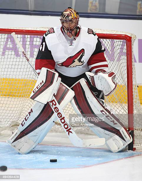 Mike Smith of the Arizona Coyotes faces a shot during the warmup prior to play against the Toronto Maple Leafs during an NHL game at the Air Canada...