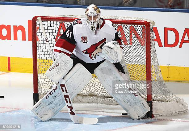 Mike Smith of the Arizona Coyotes faces a shot during the warmup prior to playing against the Toronto Maple Leafs in an NHL game at the Air Canada...