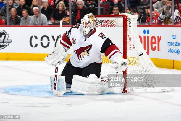 Mike Smith of the Arizona Coyotes guards the net in the first period against the Chicago Blackhawks at the United Center on February 23 2017 in...