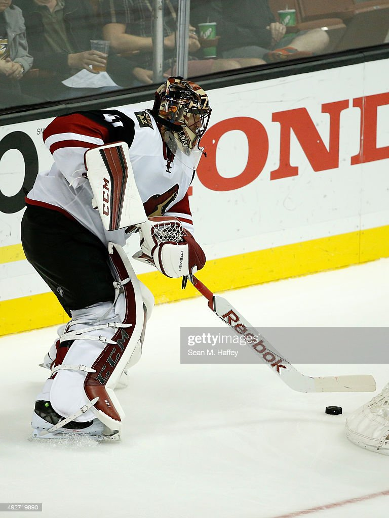 Mike Smith #41 of the Arizona Coyotes handles the puck during the third period of a game against the Anaheim Ducks at Honda Center on October 14, 2015 in Anaheim, California.