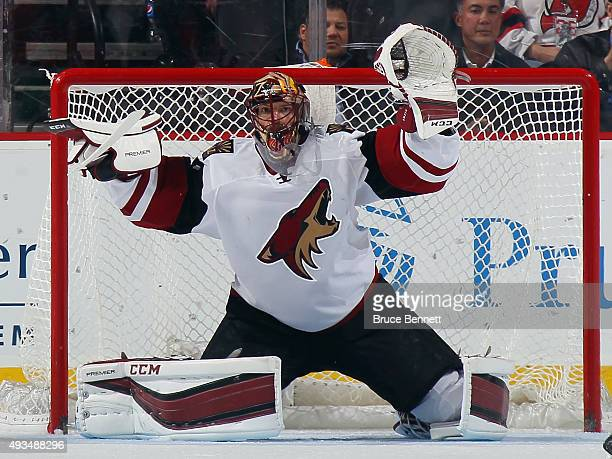 Mike Smith of the Arizona Coyotes is late to react as Mike Cammalleri of the New Jersey Devils scores at 709 of the third period at the Prudential...