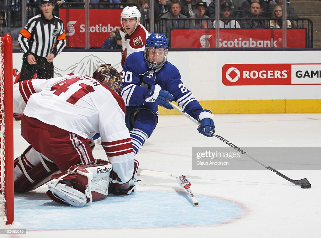 Mike Smith of the Arizona Coyotes loses his stick trying to check David Booth of the Toronto Maple Leafs during an NHL game at the Air Canada Centre...