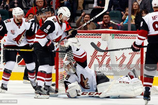 Mike Smith of the Arizona Coyotes makes a glove save against the Calgary Flames during an NHL game on February 13 2017 at the Scotiabank Saddledome...