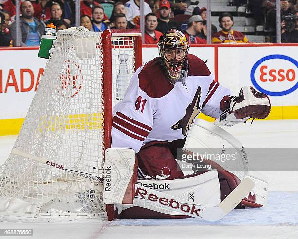Mike Smith of the Arizona Coyotes skates against the Calgary Flames during an NHL game at Scotiabank Saddledome on April 7 2015 in Calgary Alberta...